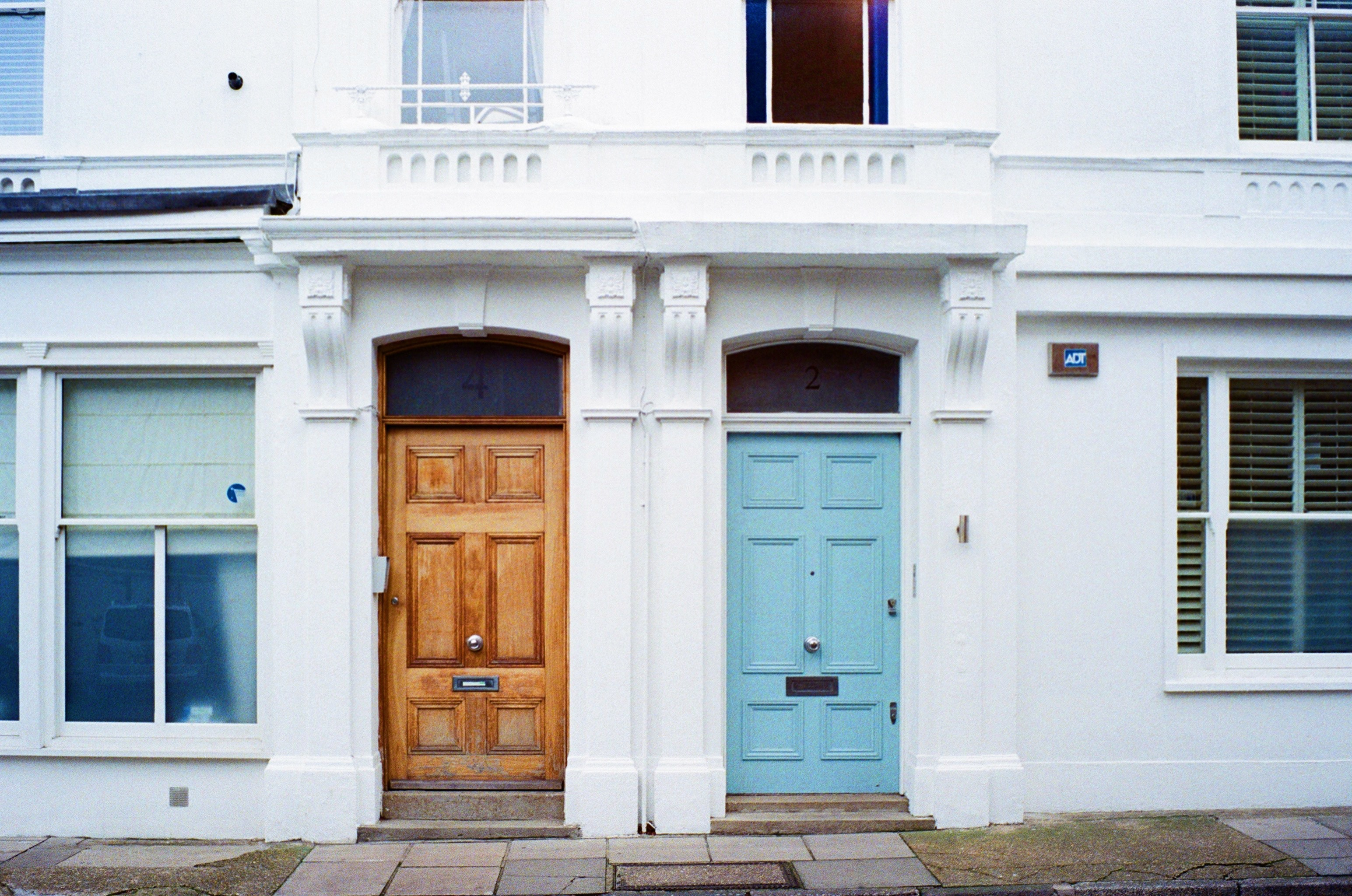 wooden and blue front doors