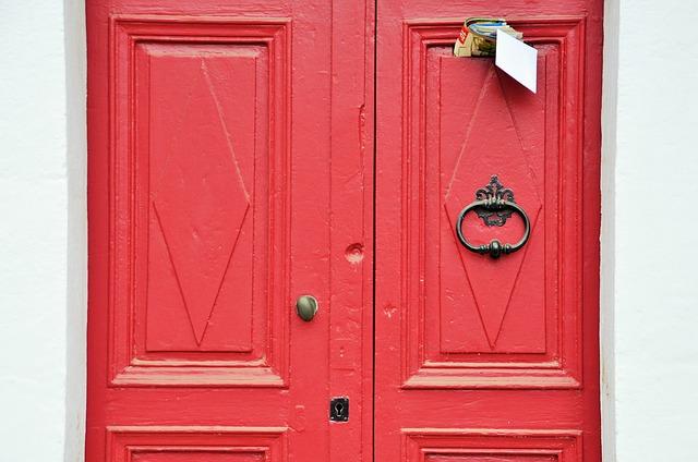red front door with knocker