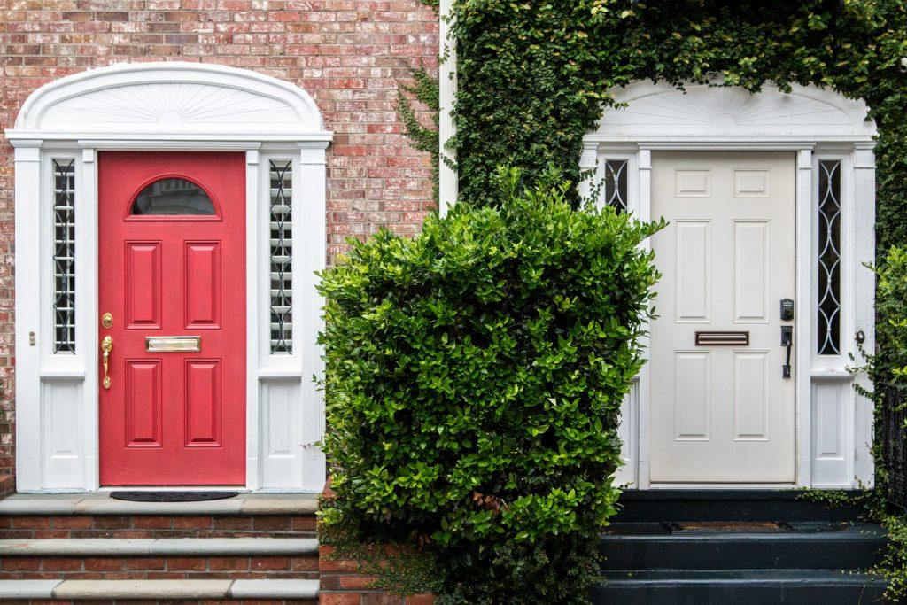 red front door on brick house