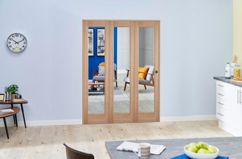 PREFINISHED Oak Roomfold Deluxe - Clear Glass: Interior Folding Door with Low Level Guide Rail Image